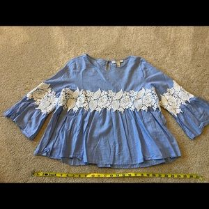 Blue and white bell sleeve top with lace detail